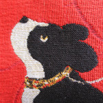 Dog pillow depicting a dog on a red background