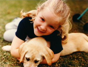Girl and Labrador Puppies